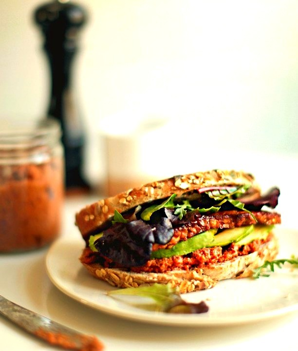 A smoky tempeh sandwich with sundried tomato pesto looks absolutely delicious.